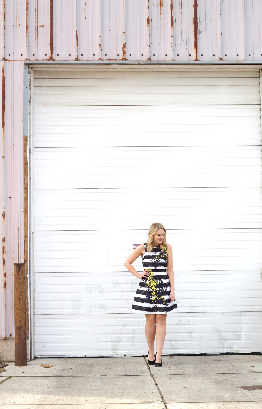 A Coast Stripes Dress balances out the urban city chicago background