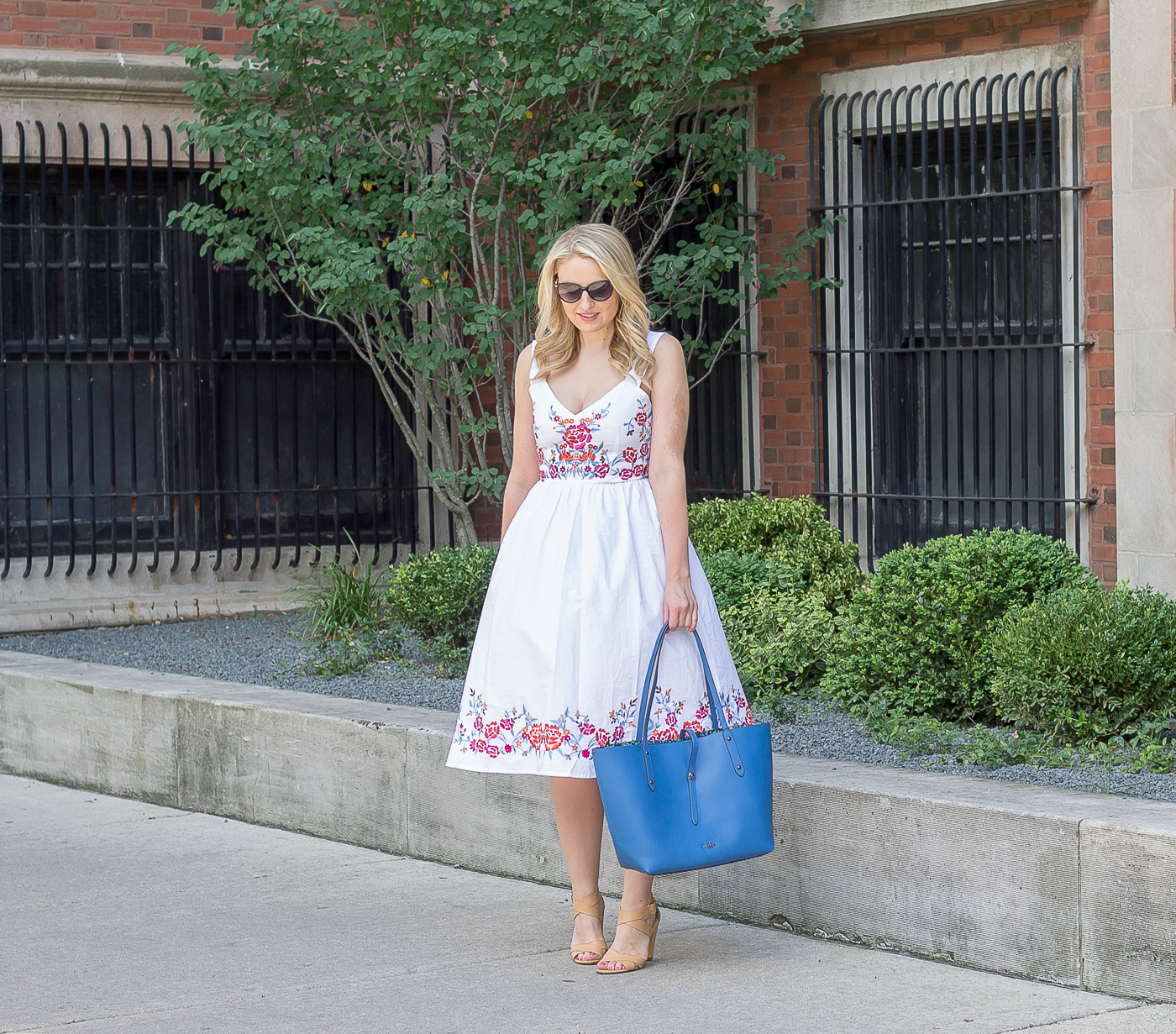 A white midi dress with embroidery