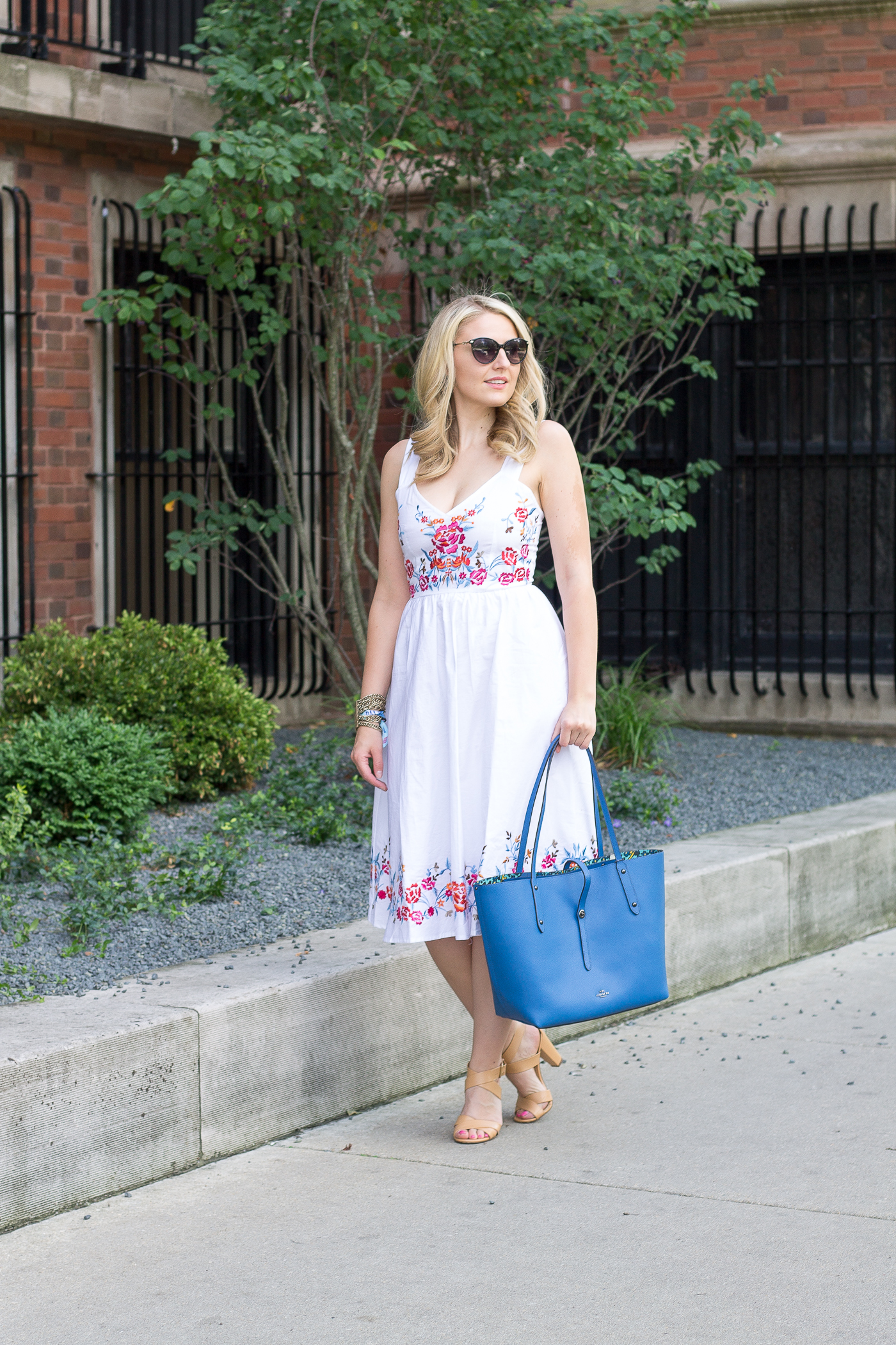 An ASOS white midi dress with floral embroidery for under $100