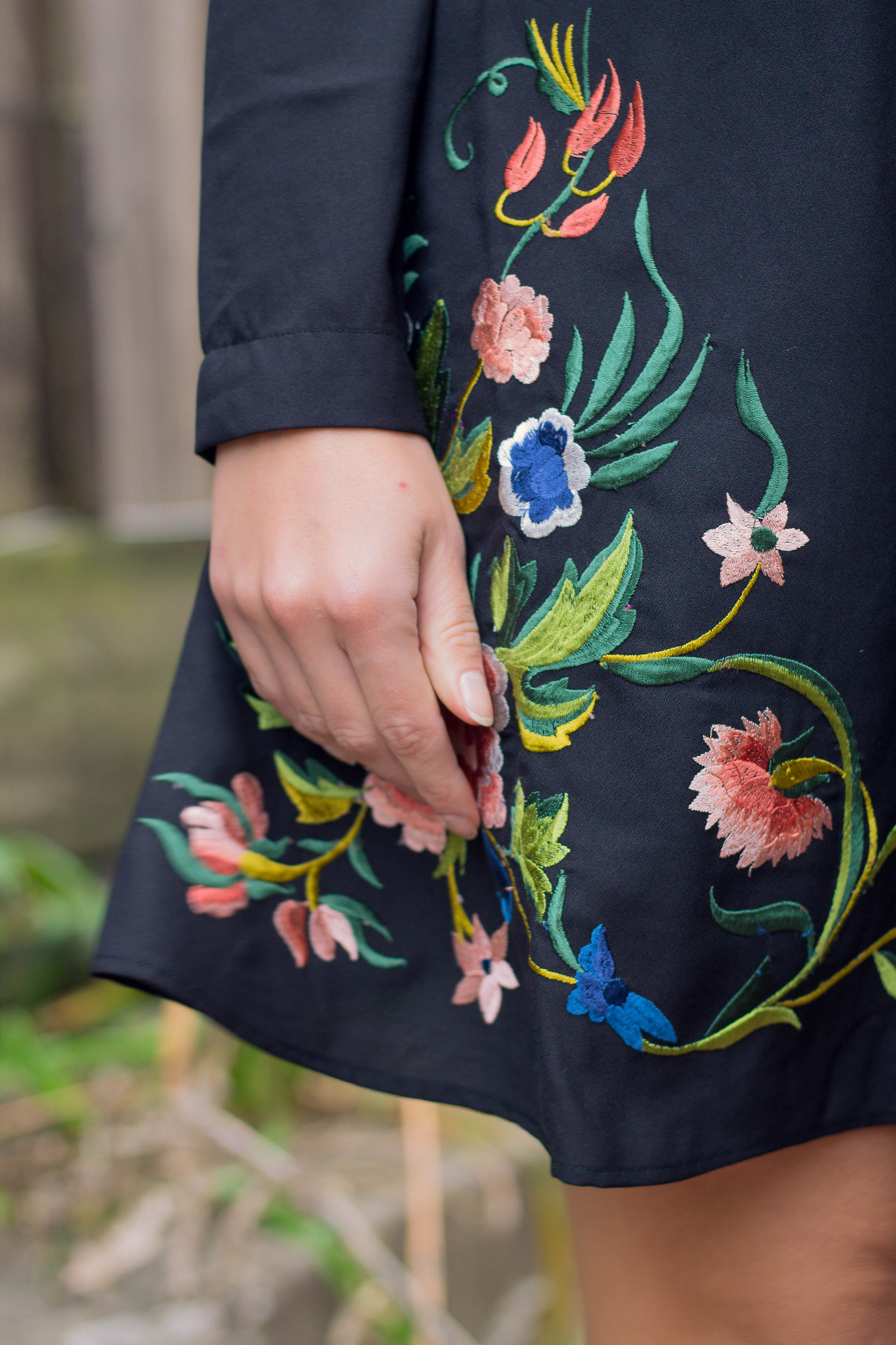 Colorful embroidery on a black dress