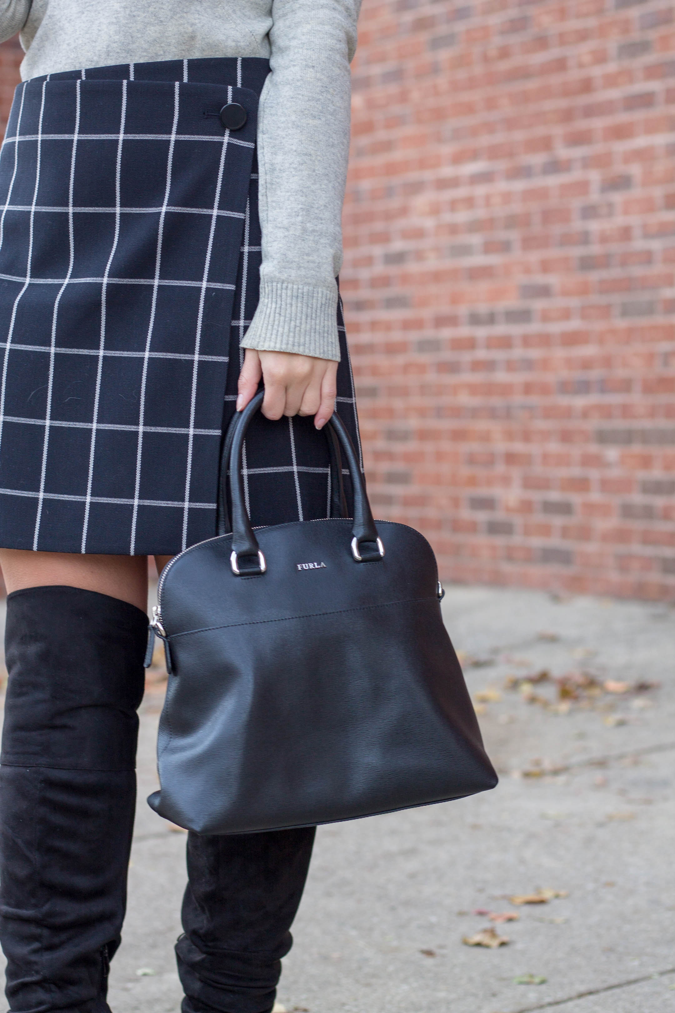 A black furla handbag