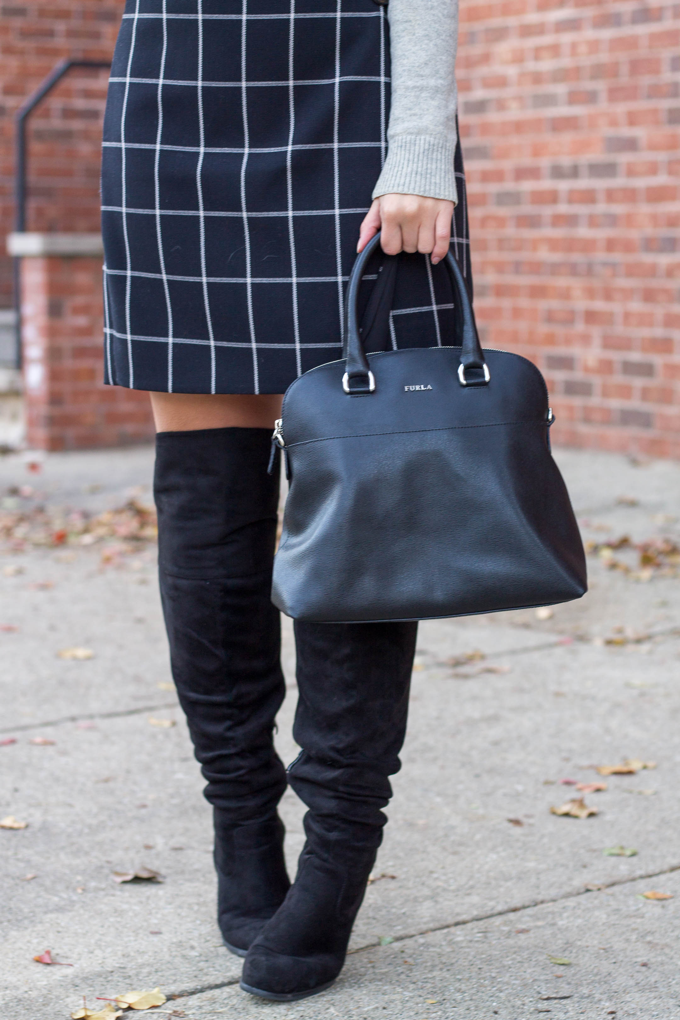 A furla handbag with Journee Collection knee high boots