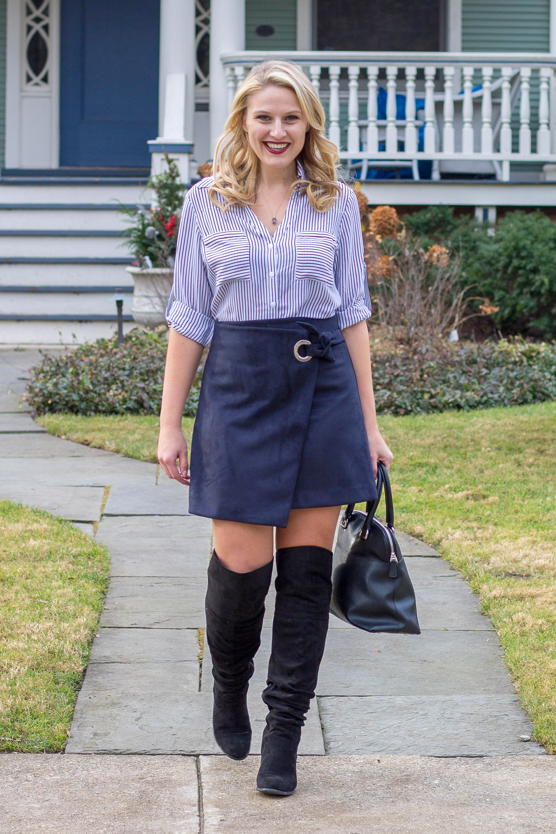 A navy grommet wrap skirt is a great way to add color to your winter wardrobe
