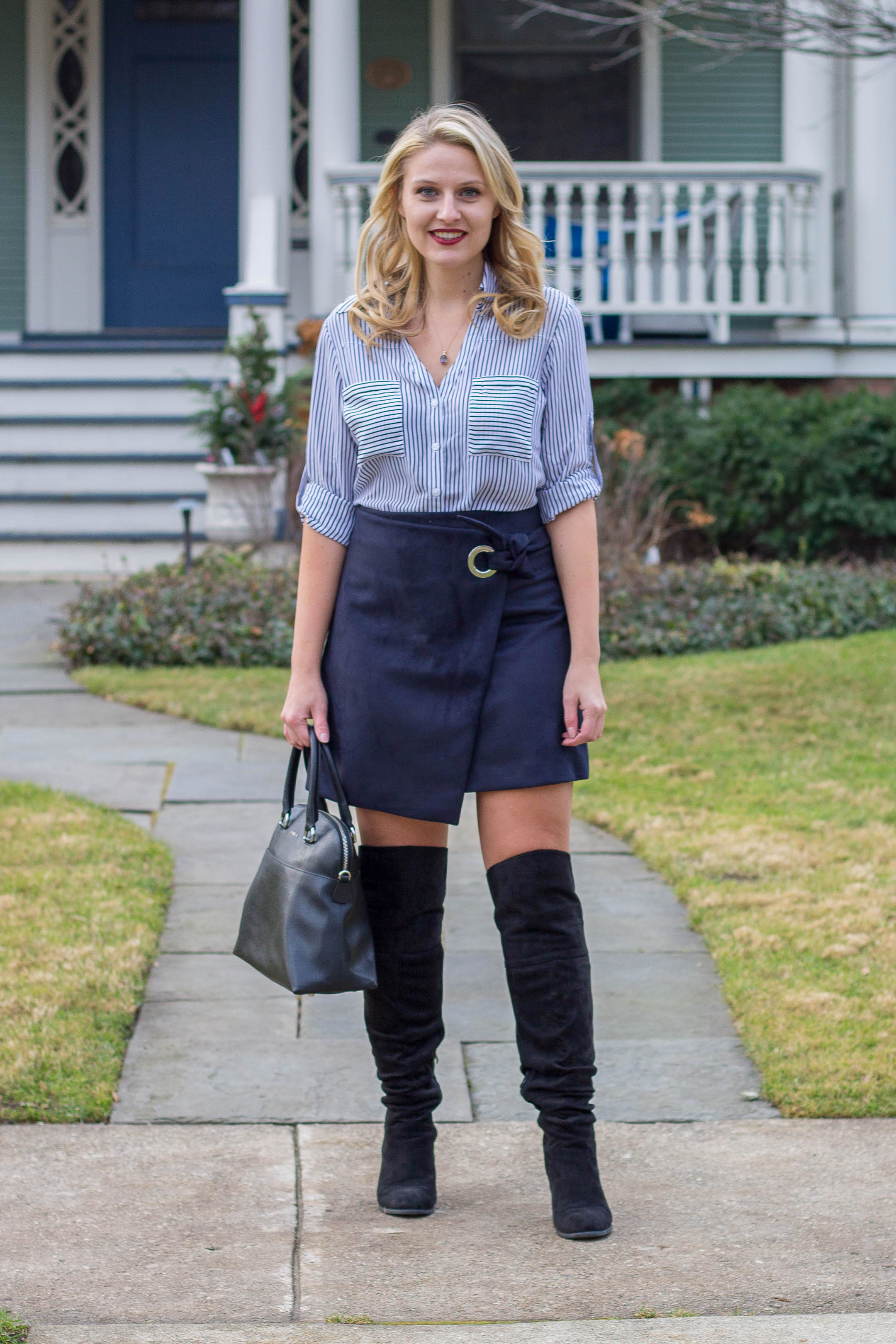 A winter workplace outfit featuring a faux suede wrap skirt