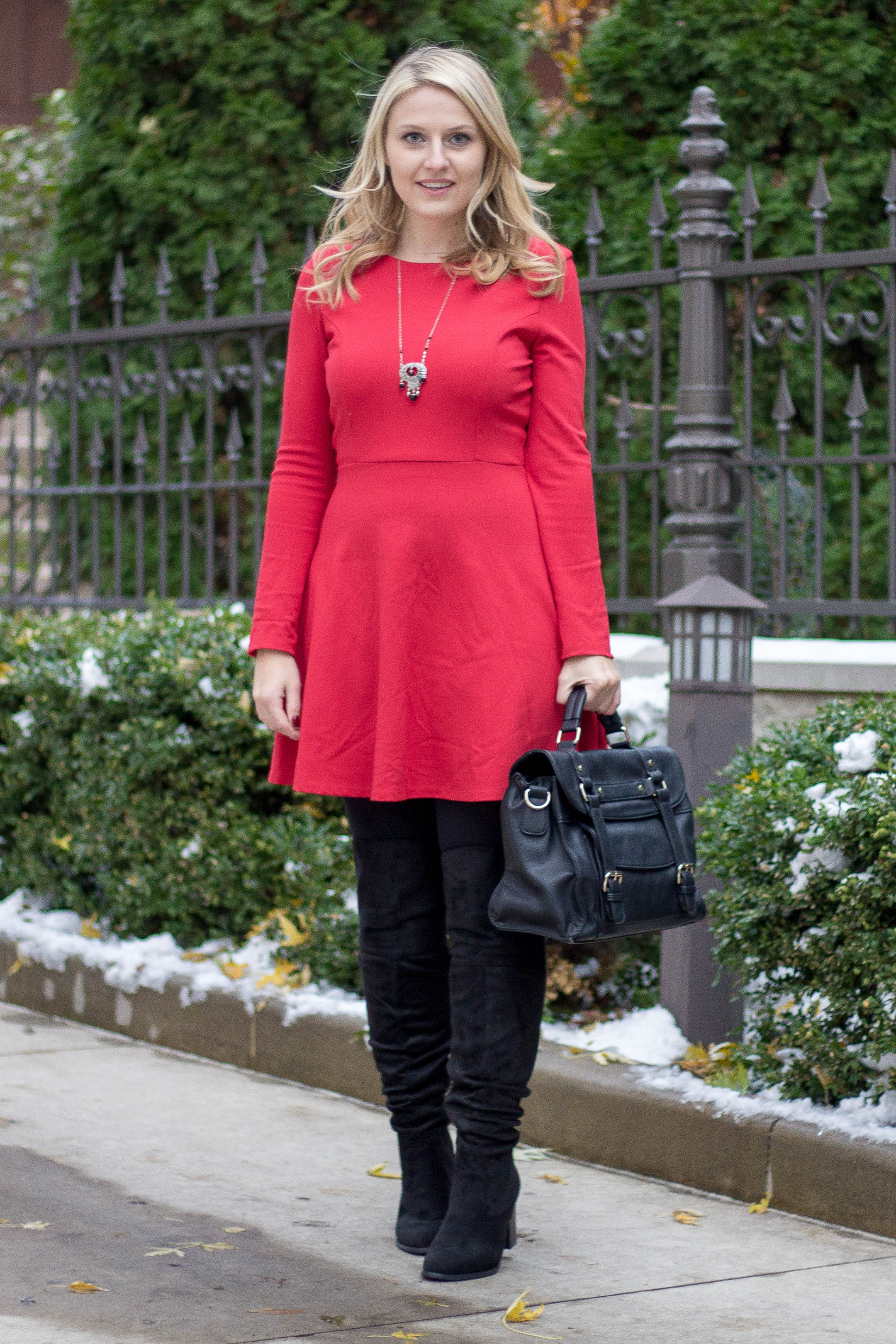 A easy winter work outfit wearing a long sleeve red dress