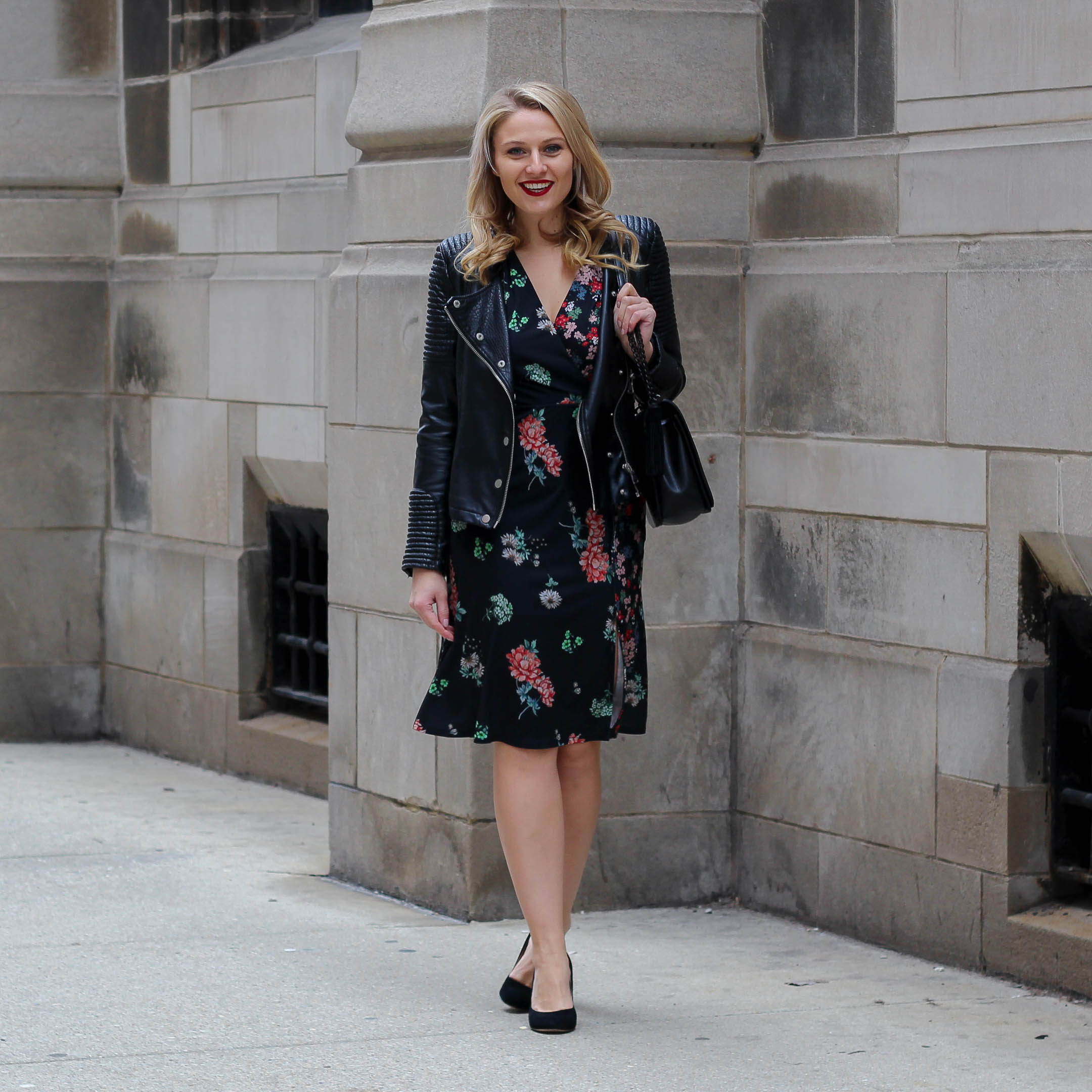 A night out on the town outfit featuring a midi floral dress with a faux leather biker jacket