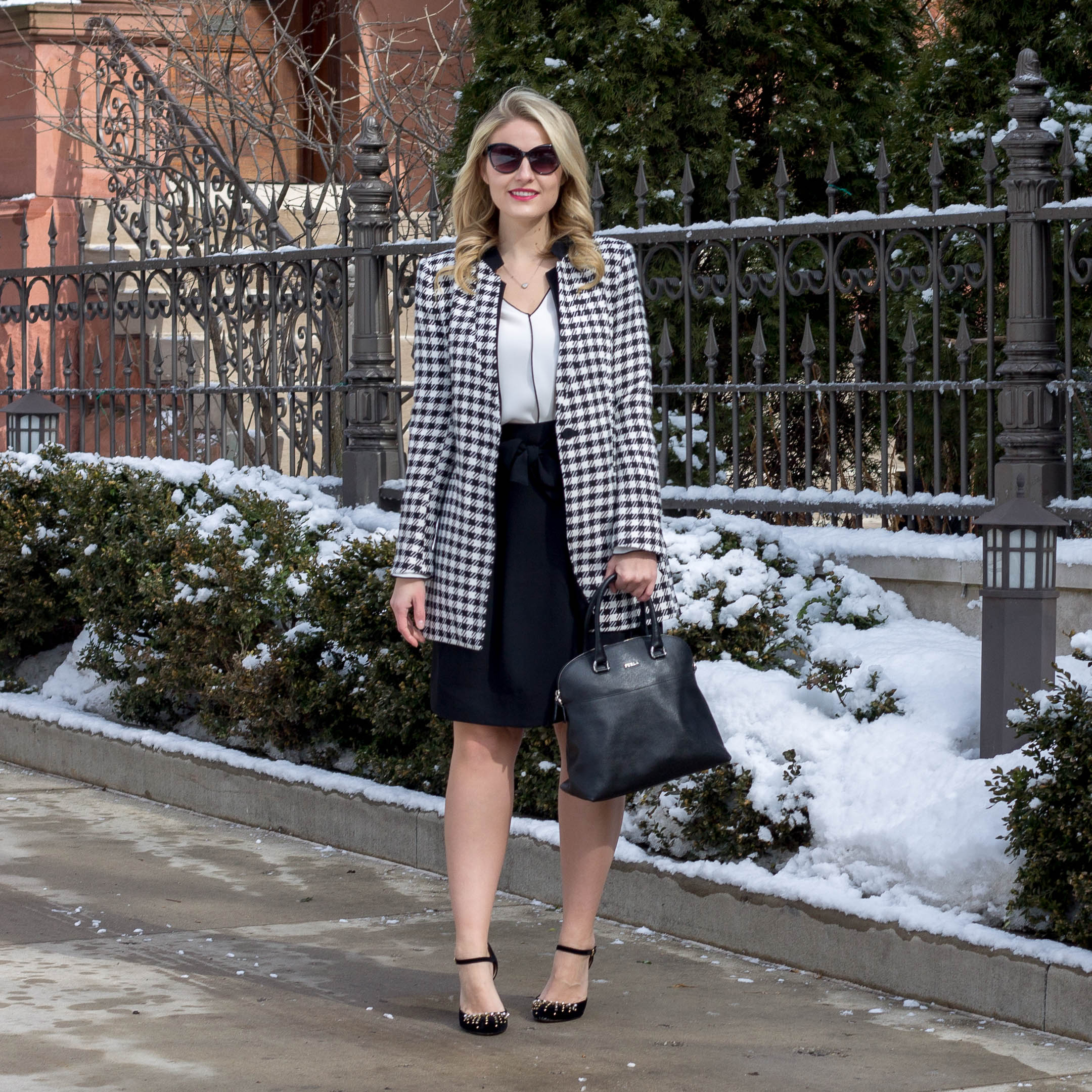 A professional winter work outfit including a houndstooth jacket