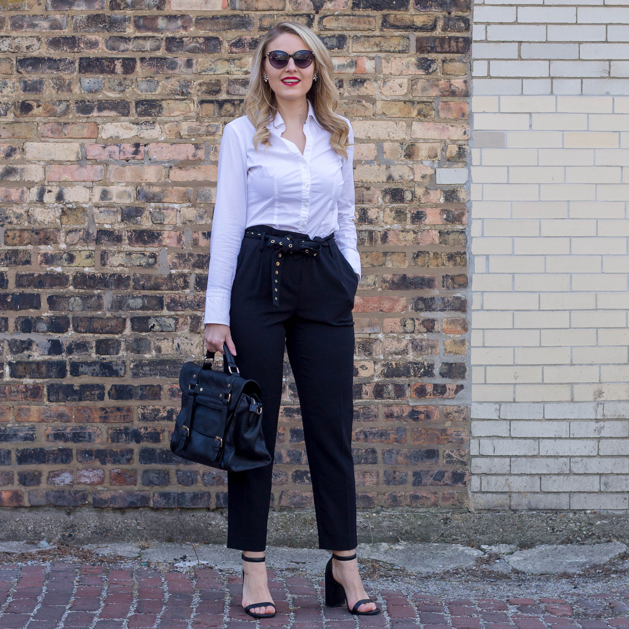 A simple black and white outfit for the corporate workplace featuring the Calvin Kelin cropped pant with studded belt