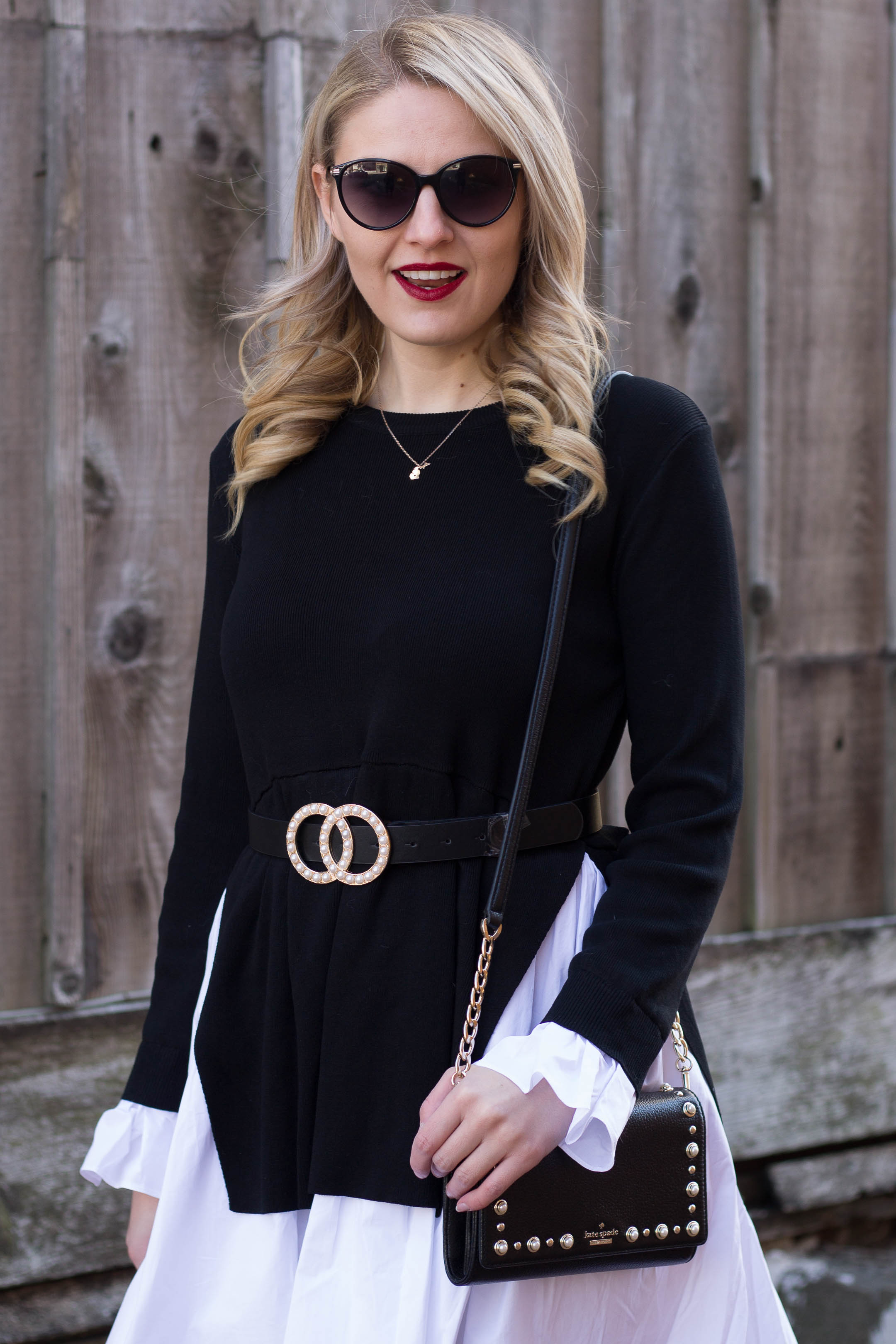 An all black and white outfit featuring this circle pearl belt