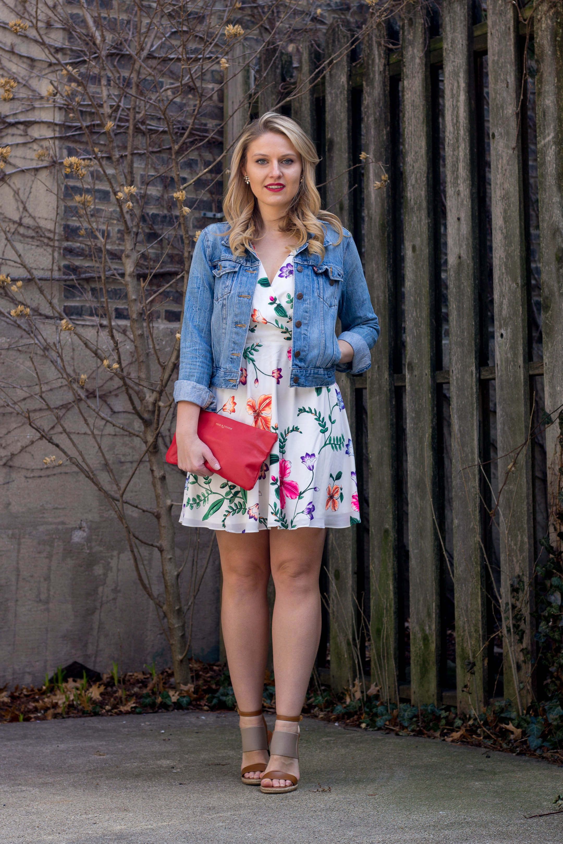 A simple vacation outfit featuring a floral dress and jean jacket