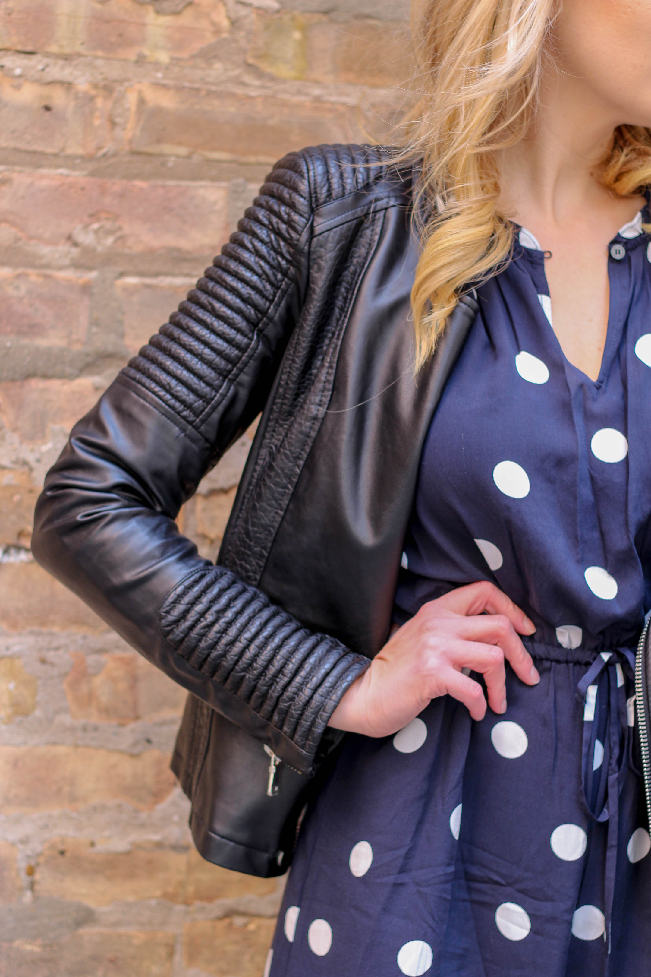 How to wear a faux leather moto jacket this spring